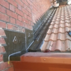 Stepped cover flashing  with parapet capping (Ferry Building)